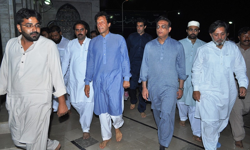 Imran Khan is seen at the shrine.— Photo by author