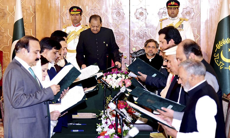 President Mamnoon Hussain, front on left, administers oath to ministers in Islamabad on Friday.— PID via AP