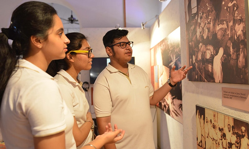 Indian students look at photographs taken during the time of Partition at the Partition Museum in Amritsar.— AFP