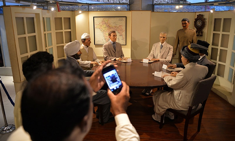 Visitors look at the statues of Quaid-i-Azam Muhammad Ali Jinnah (centre R), British viceroy Lord Mountbatten (centre L) and other Indian leaders at a conference table at the Pakistan Monument Museum in Islamabad.— AFP
