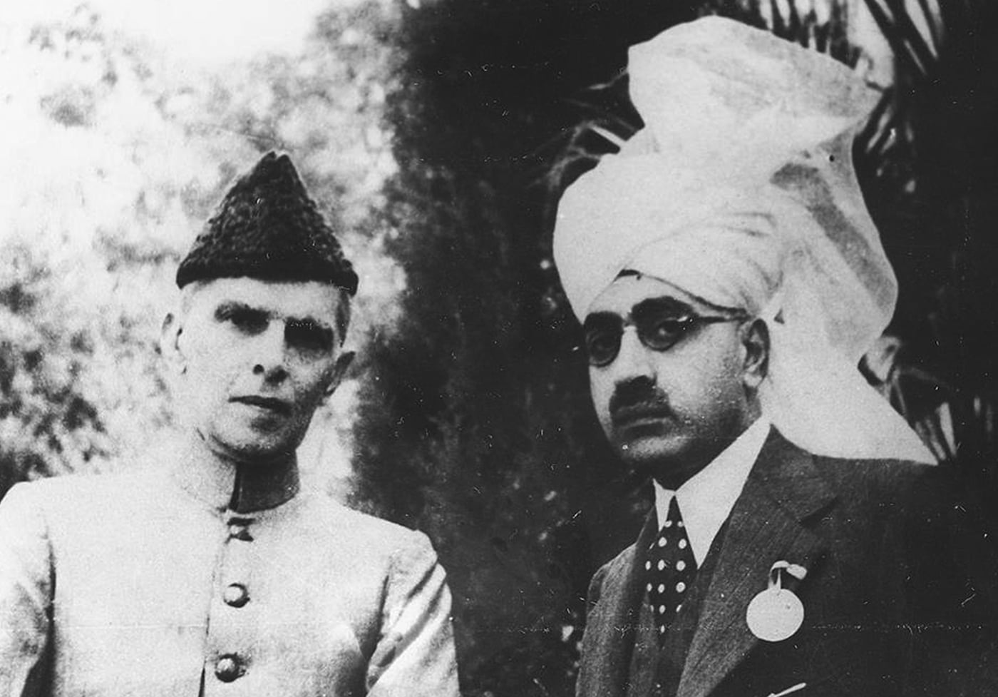Quaid-i-Azam Mohammad Ali Jinnah with Sir Sikandar Hayat Khan, probably at the time when the Jinnah-Sikandar Pact is signed in 1937. — Courtesy National Archives Islamabad