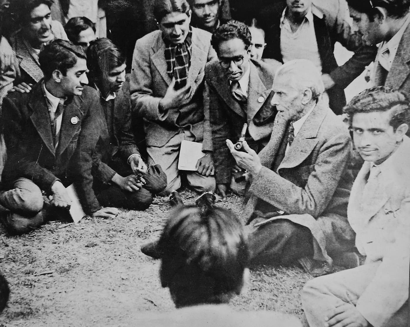 Quaid-i-Azam Mohammad Ali Jinnah in animated conversation with a group of students on the lawns of the University of Punjab, Lahore, on January 7, 1946. The photograph is taken by the prominent photographer of the Pakistan Movement, Faustin Elmer Chaudhry. — Courtesy Lahore Museum Archives