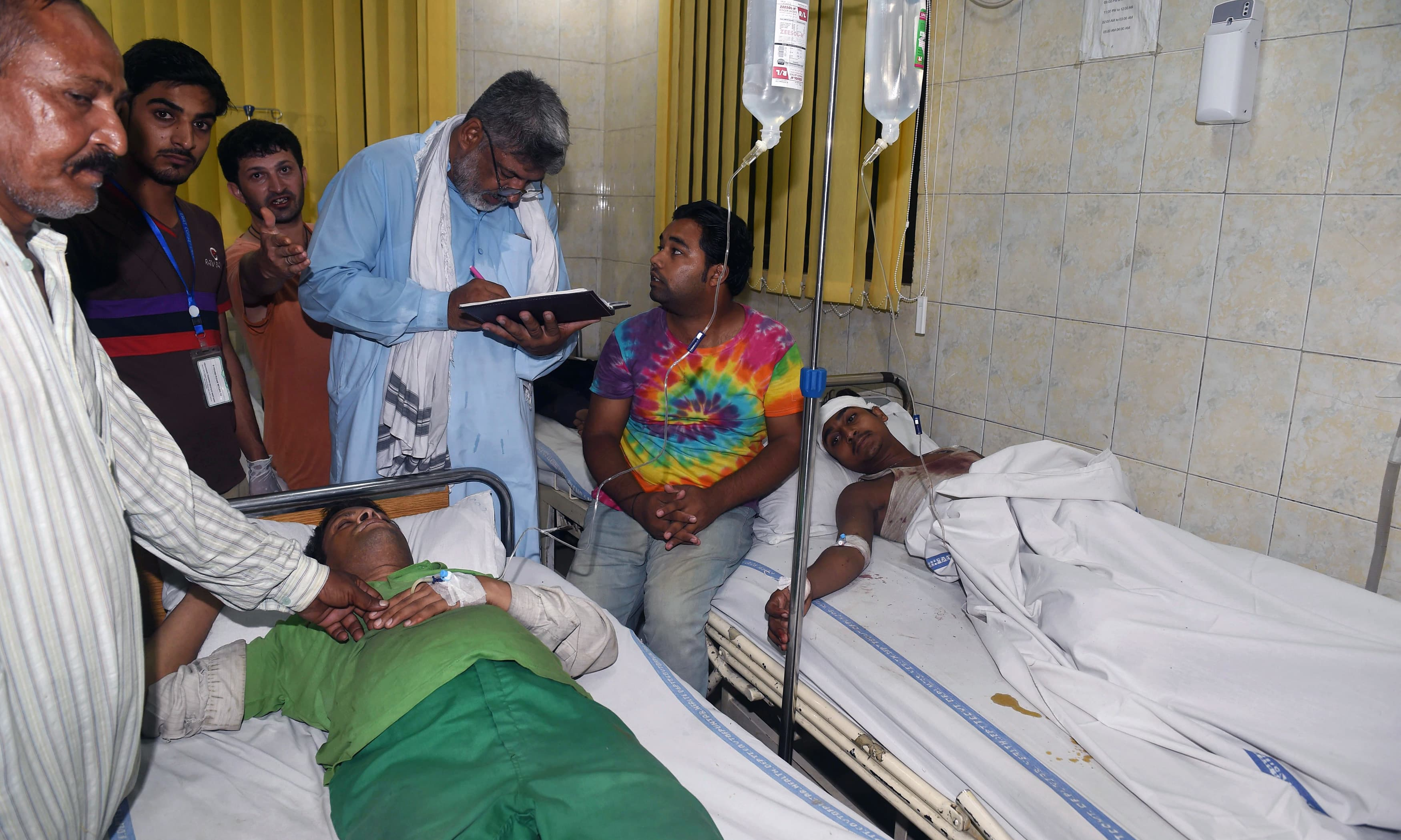 Injured blast victims receive medical attention in Lahore. —AFP