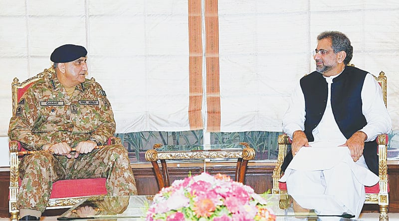 ISLAMABAD: Army Chief Gen Qamar Javed Bajwa meets Prime Minister Shahid Khaqan Abbasi at Prime Minister's Office on Tuesday. The seating arrangement caught the eye of observers and was interpreted by many as the return to the old setting for PM-COAS meetings that was in vogue before the last change of command in the army.—APP