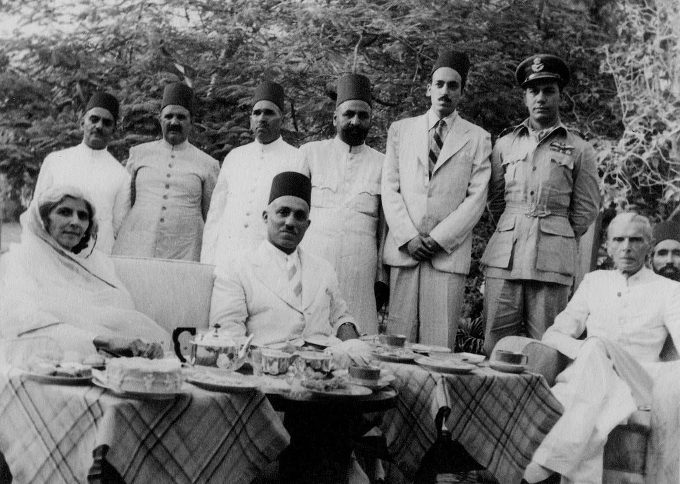 Quaid-i-Azam Mohammad Ali Jinnah and Miss Fatima Jinnah enjoy high tea with the Amir of Bahawalpur, Nawab Sadiq Mohammad Khan Abbasi V, possibly at his retreat in Malir, on the outskirts of Karachi. Standing in a white suit, between the Amir and Mr Jinnah, is his son, the future Nawab. On the extreme left, behind Miss Jinnah, is Colonel Hashmi, ADC to the Amir. — Courtesy Princess Yasmien Abbasi Archive London