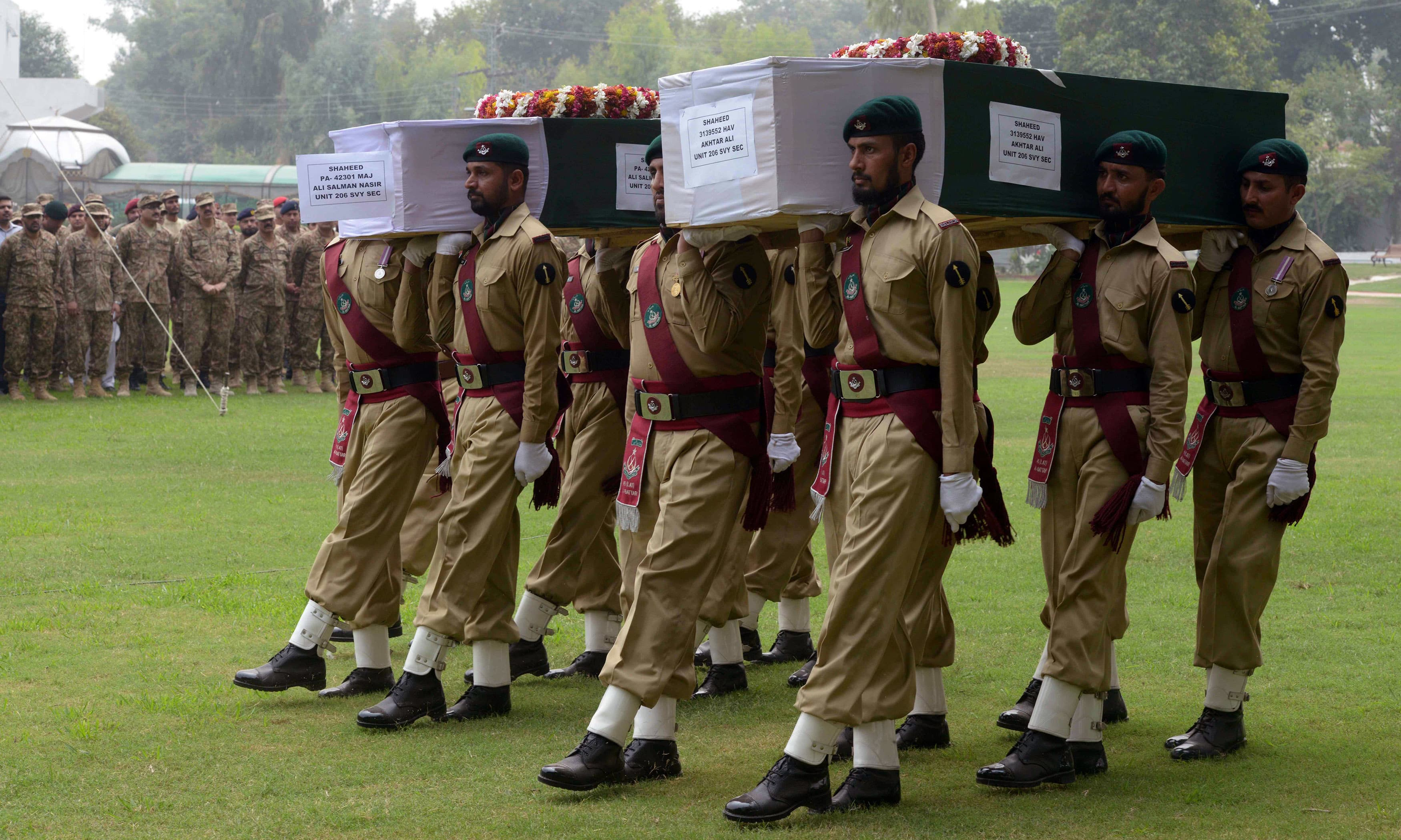 Military personnel carry the coffin of a soldier during a funeral ceremony in Peshawar. —AFP
