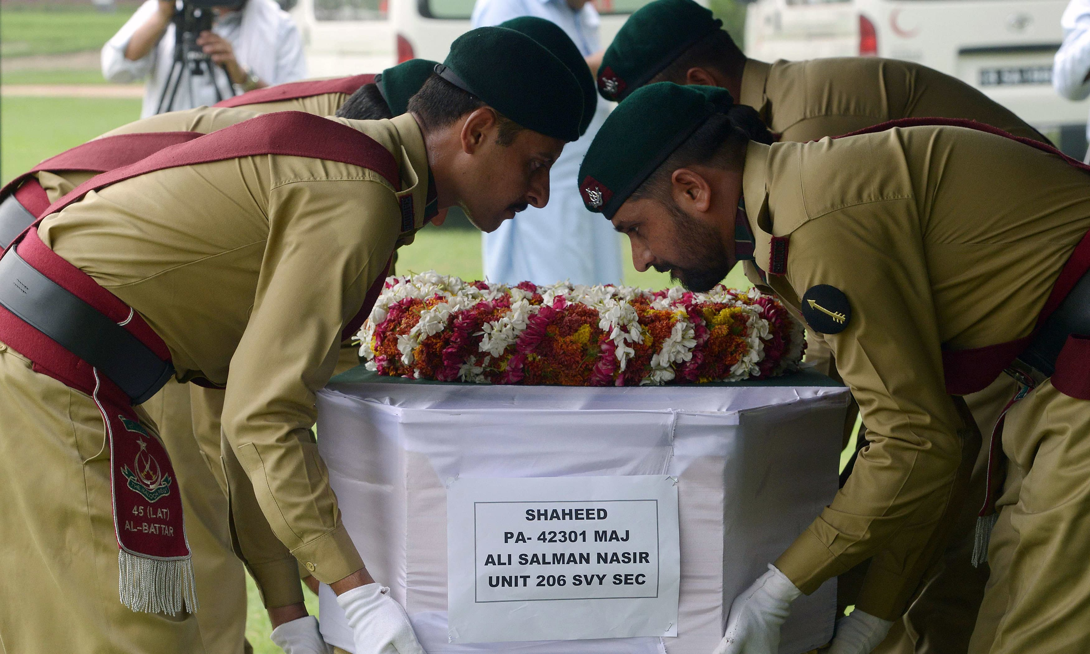 Soldiers carry the coffin of Maj Ali during a funeral ceremony in Peshawar. —AFP