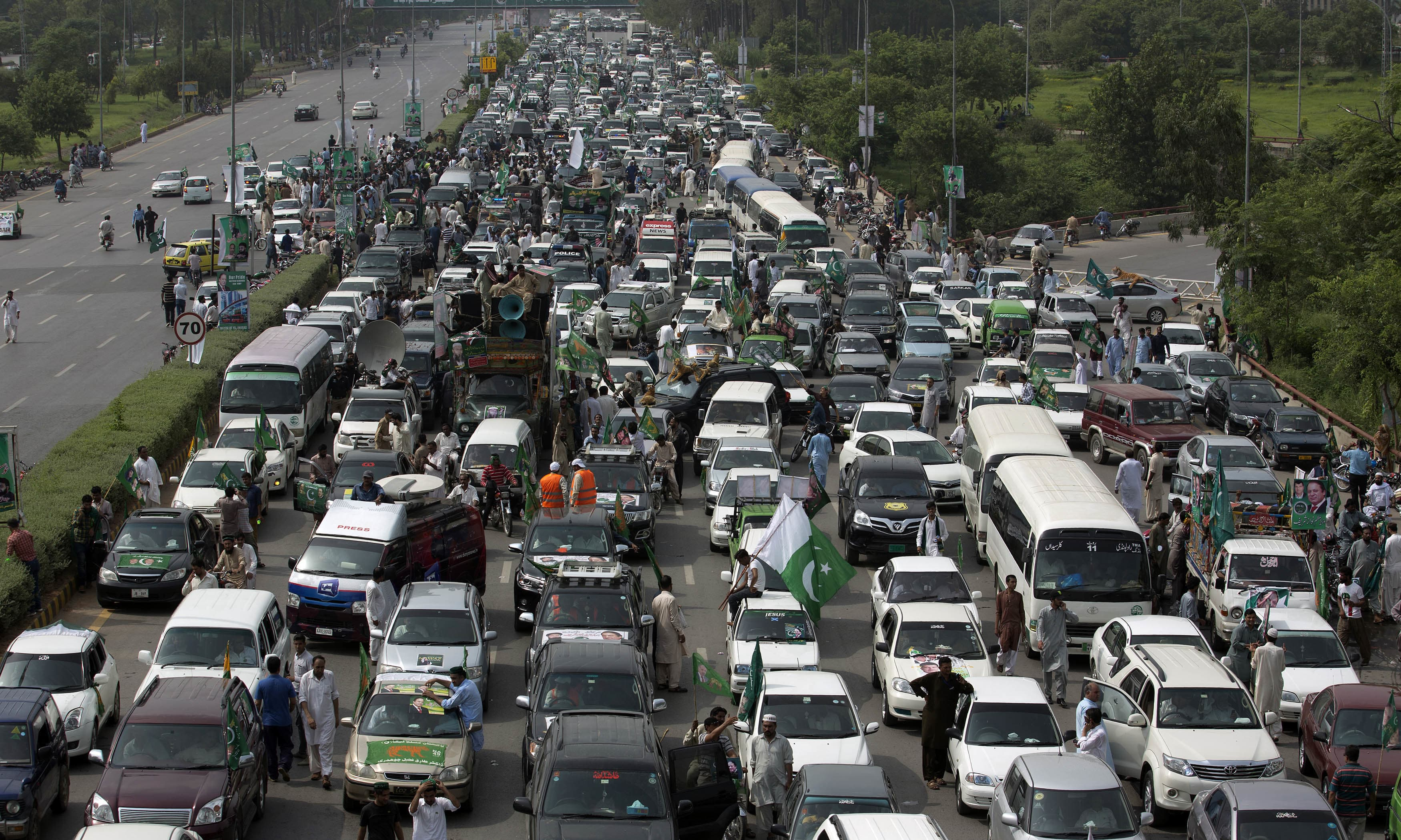 Nawaz Sharif on his way to Lahore during a rally in Islamabad. —AP