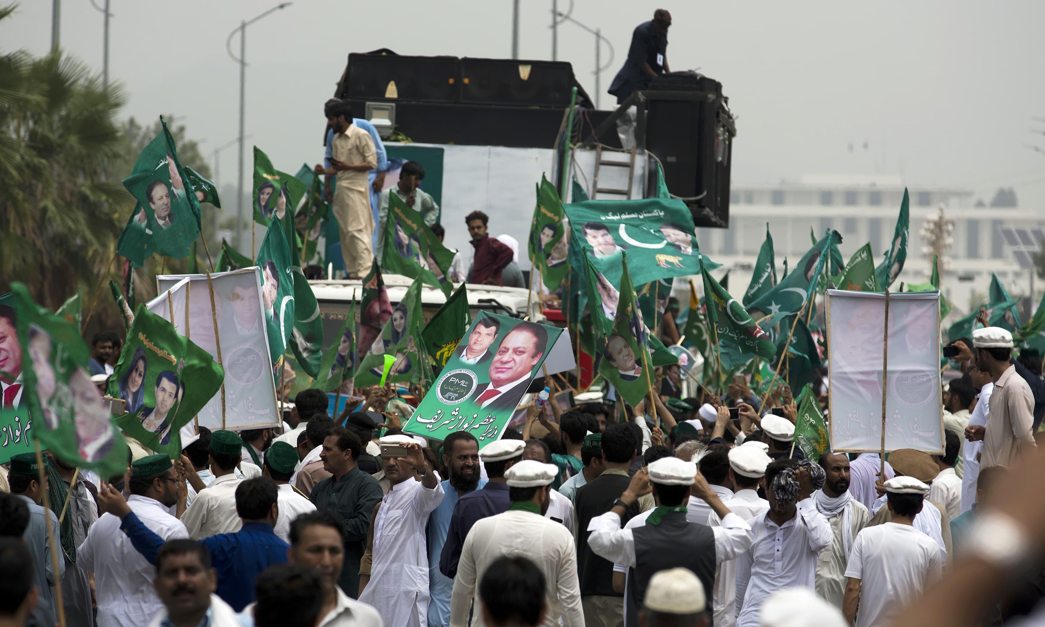 A convoy carrying Nawaz Sharif leaves Islamabad. —AP
