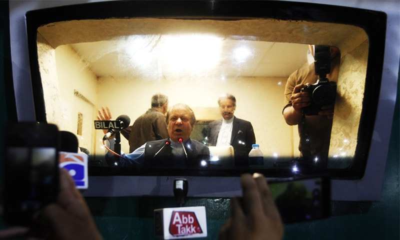 Nawaz Sharif addresses his supporters from inside a vehicle during a rally in Islamabad. ─ AP