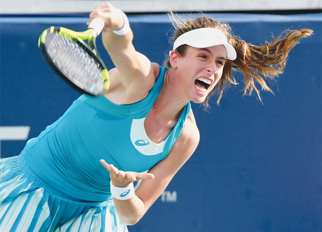 TORONTO: Johanna Konta of Great Britain plays a shot against Russia's Ekaterina Makarova.—Reuters