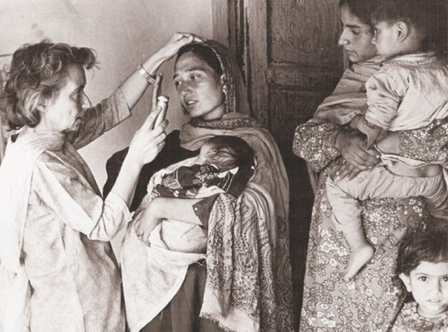 Dr Ruth Pfau examining leprosy patients during fieldwork in Azad Jammu and Kashmir.