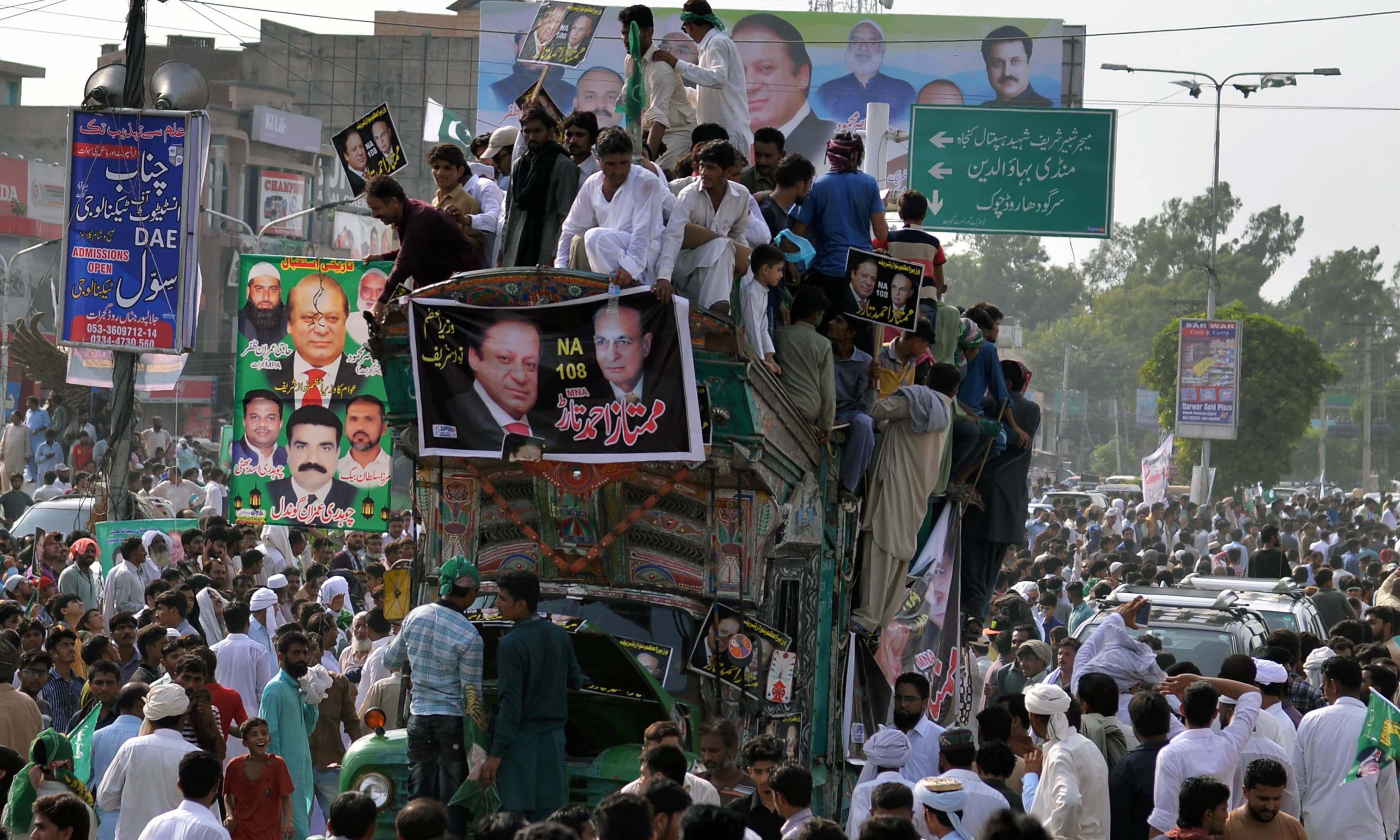 Supporters of Nawaz Sharif attend a rally in Gujrat. —AFP