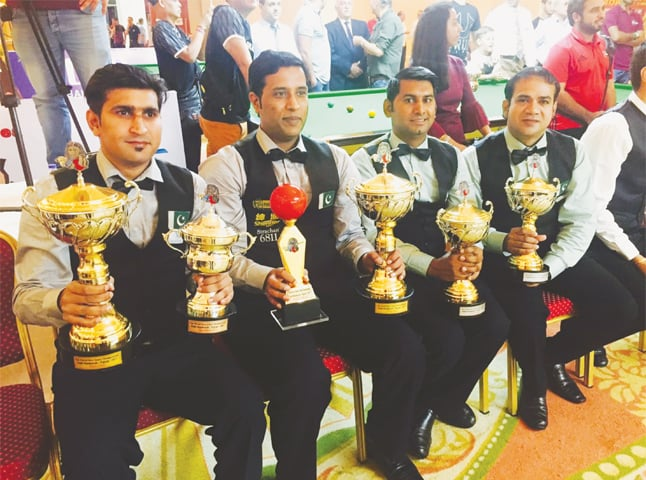KARACHI: (L to R) Babar Masih, Mohammad Asif, Asjad Iqbal and Mohammad Sajjad with their trophies after the presentation.