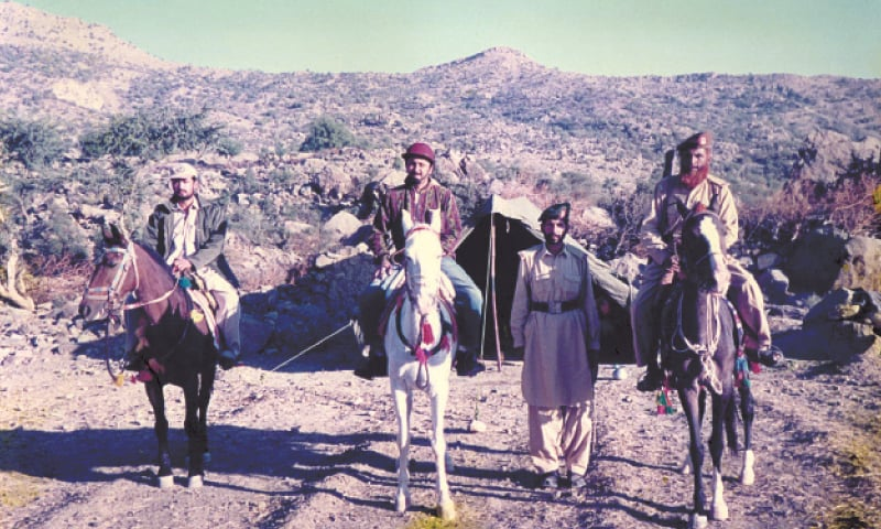 DERA GHAZI KHAN: Political agent to tribal area Dr Raheel (centre) on a visit to Jhandi in 2000.