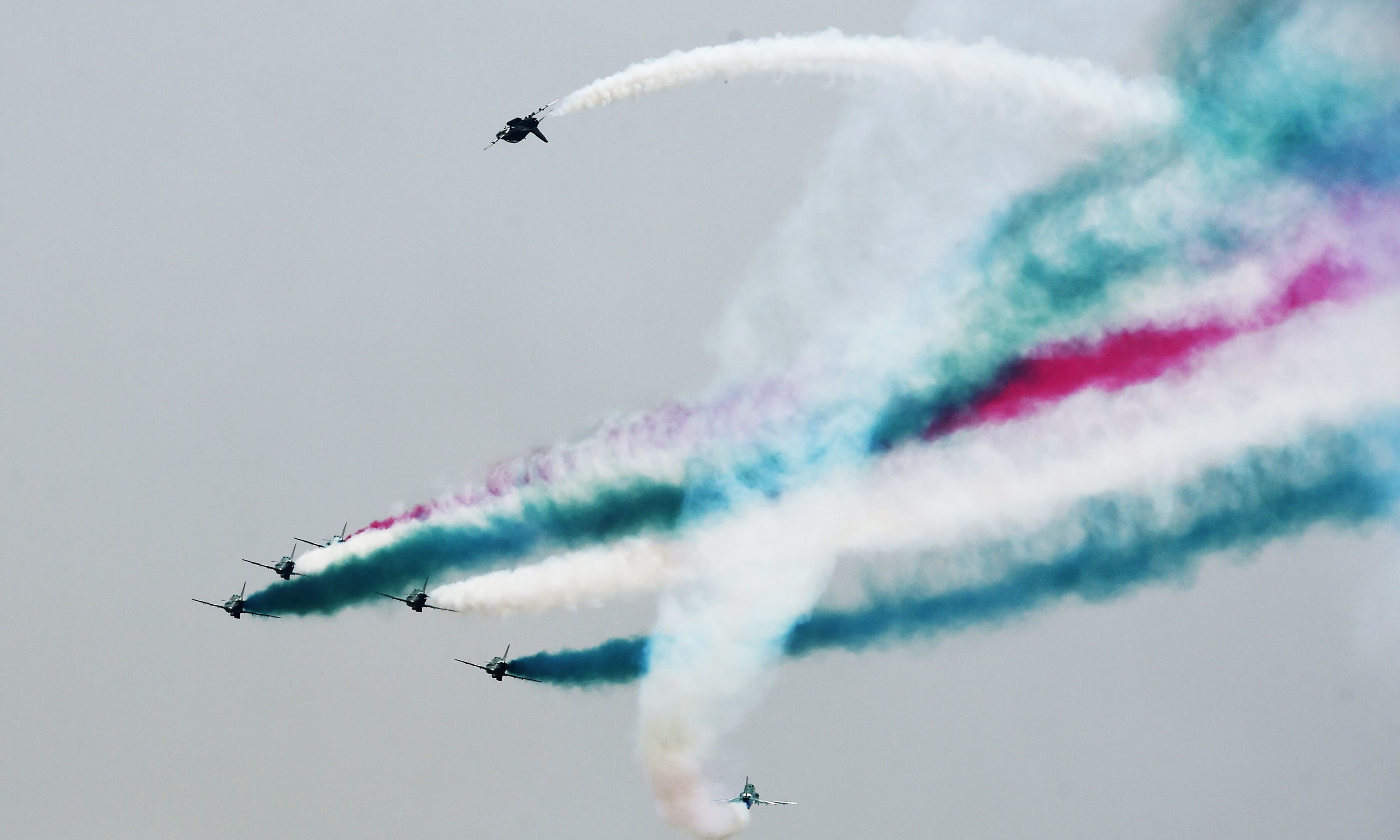 An aerobatic team performs during a rehearsal ahead of Independence day celebrations in Islamabad. —AFP
