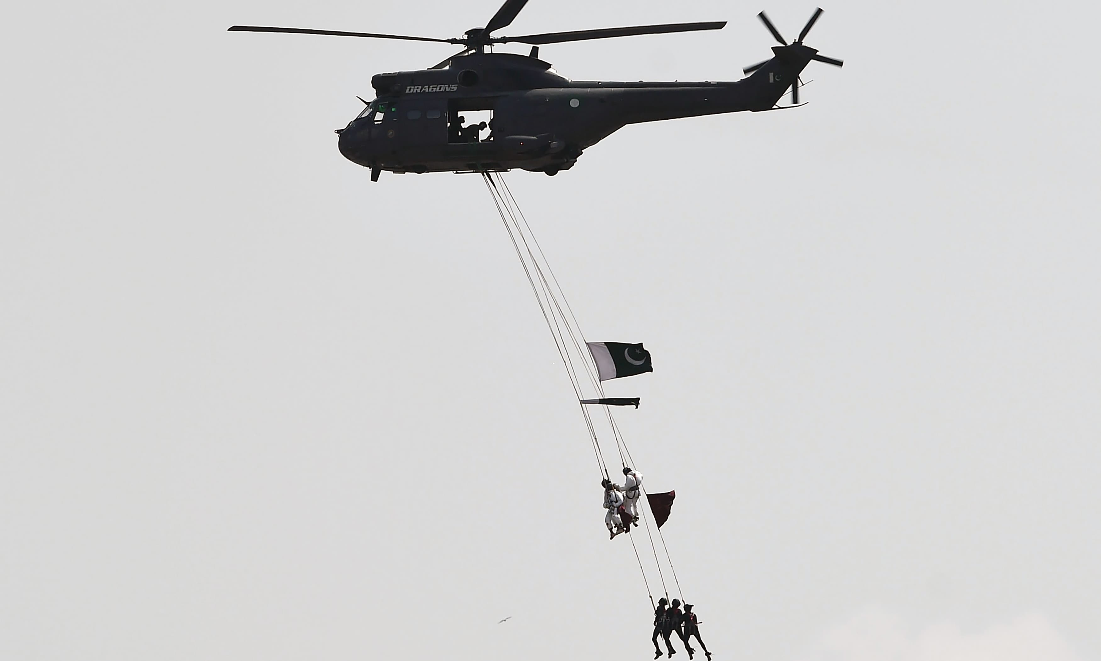 Soldiers rehearse ahead of Independence day celebrations in Islamabad. —AFP