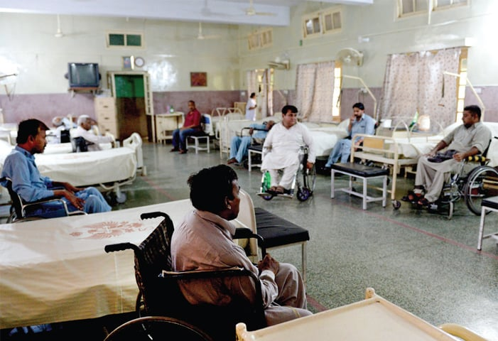Residents of the hospice sit by their beds before lunch. — Photos by Mohammad Asim
