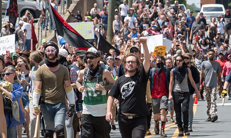 Protesters march in Charlottesville, Virginia. ─ AFP