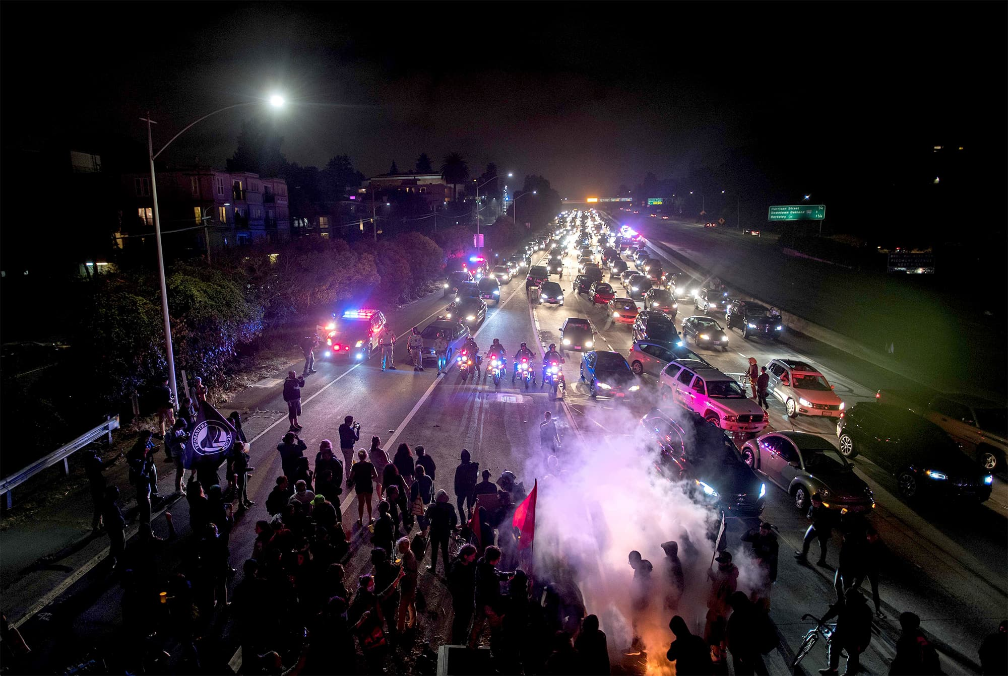 Protesters block both directions of the Interstate 580 freeway during a rally against racism in Oakland. ─ AFP