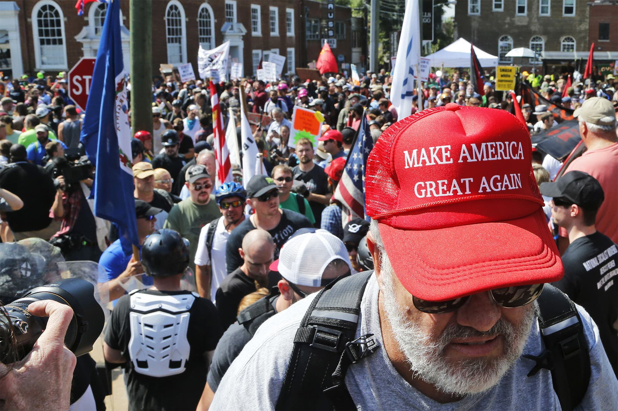 A white supremacist demonstrator walks into Lee Park in Charlottesville.  ─ AP