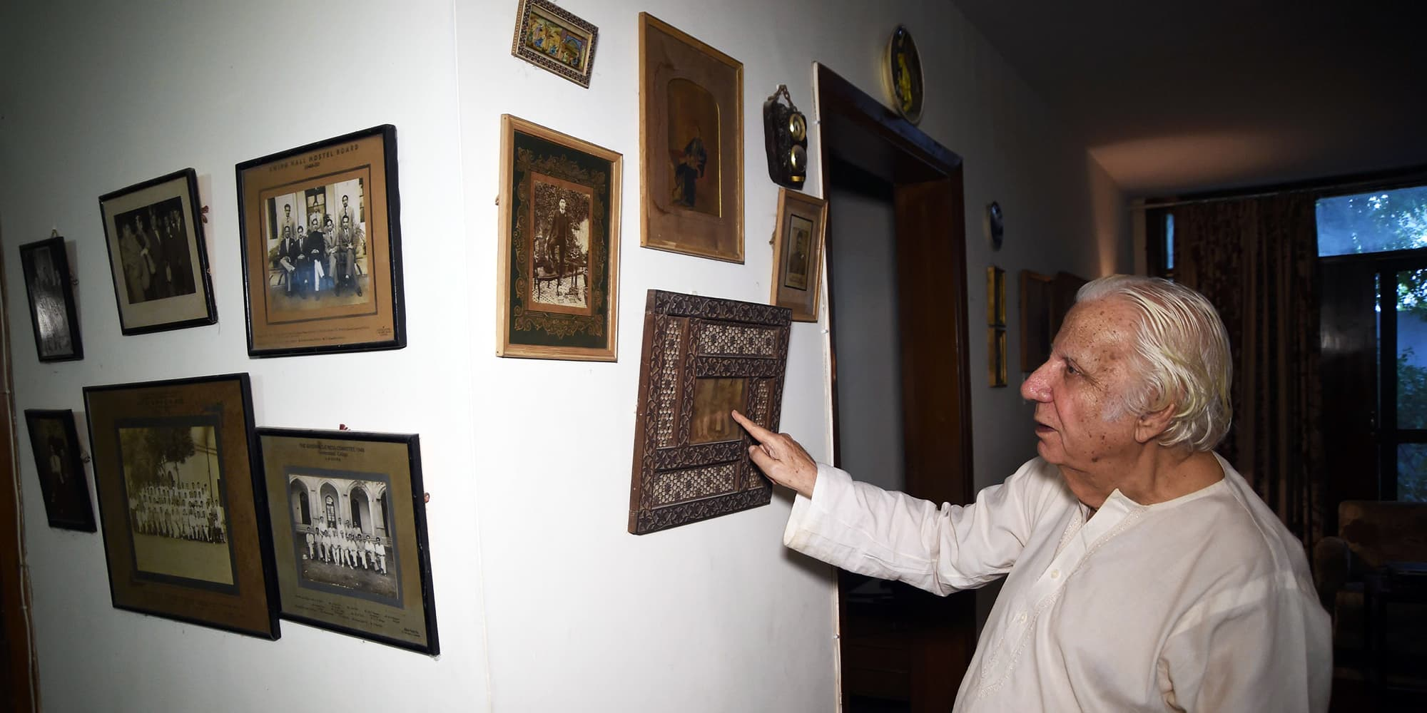 Saeed Hasan Khan displays old photos in Karachi. Khan was 17 years old, trapped in east Punjab in September of 1947 as the killing continued. — AFP
