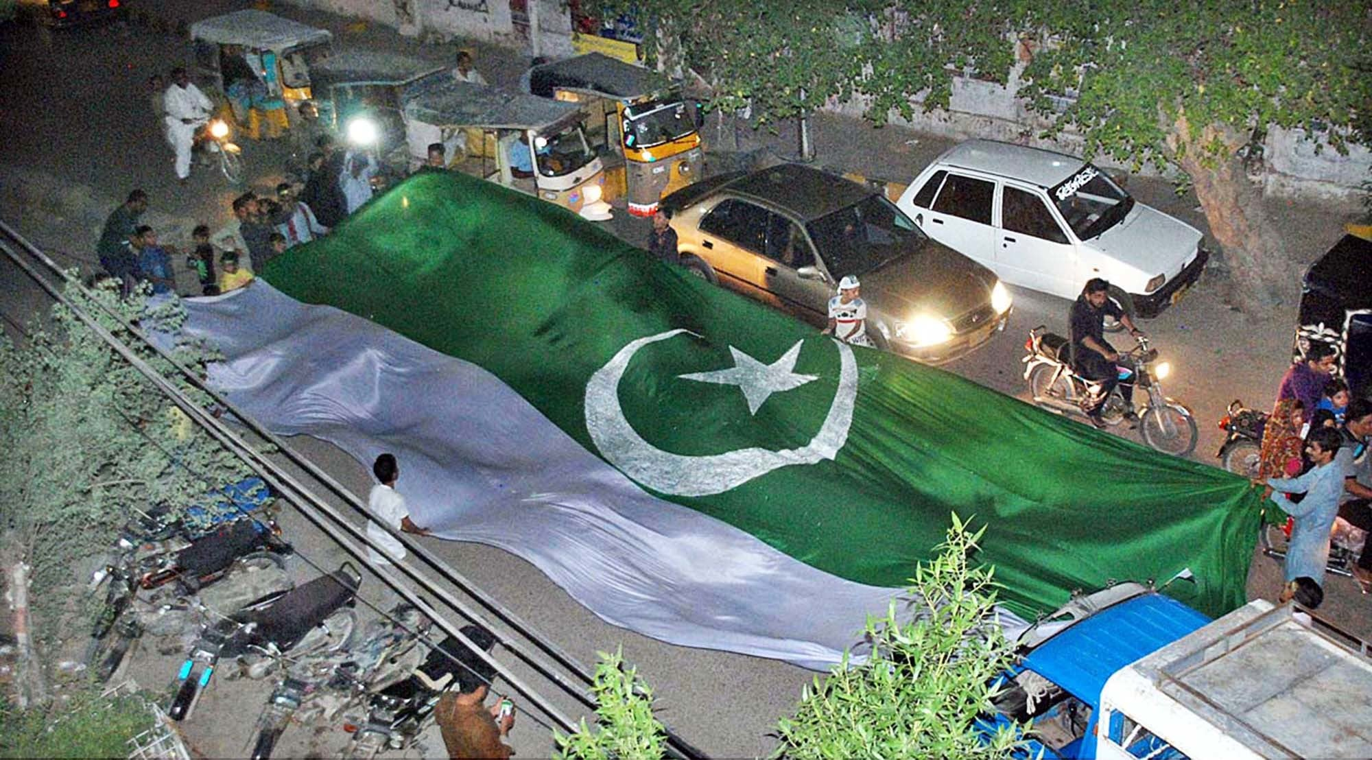 Street celebrations in Hyderabad on the eve of Pakistan's 70th Independence Day. — APP