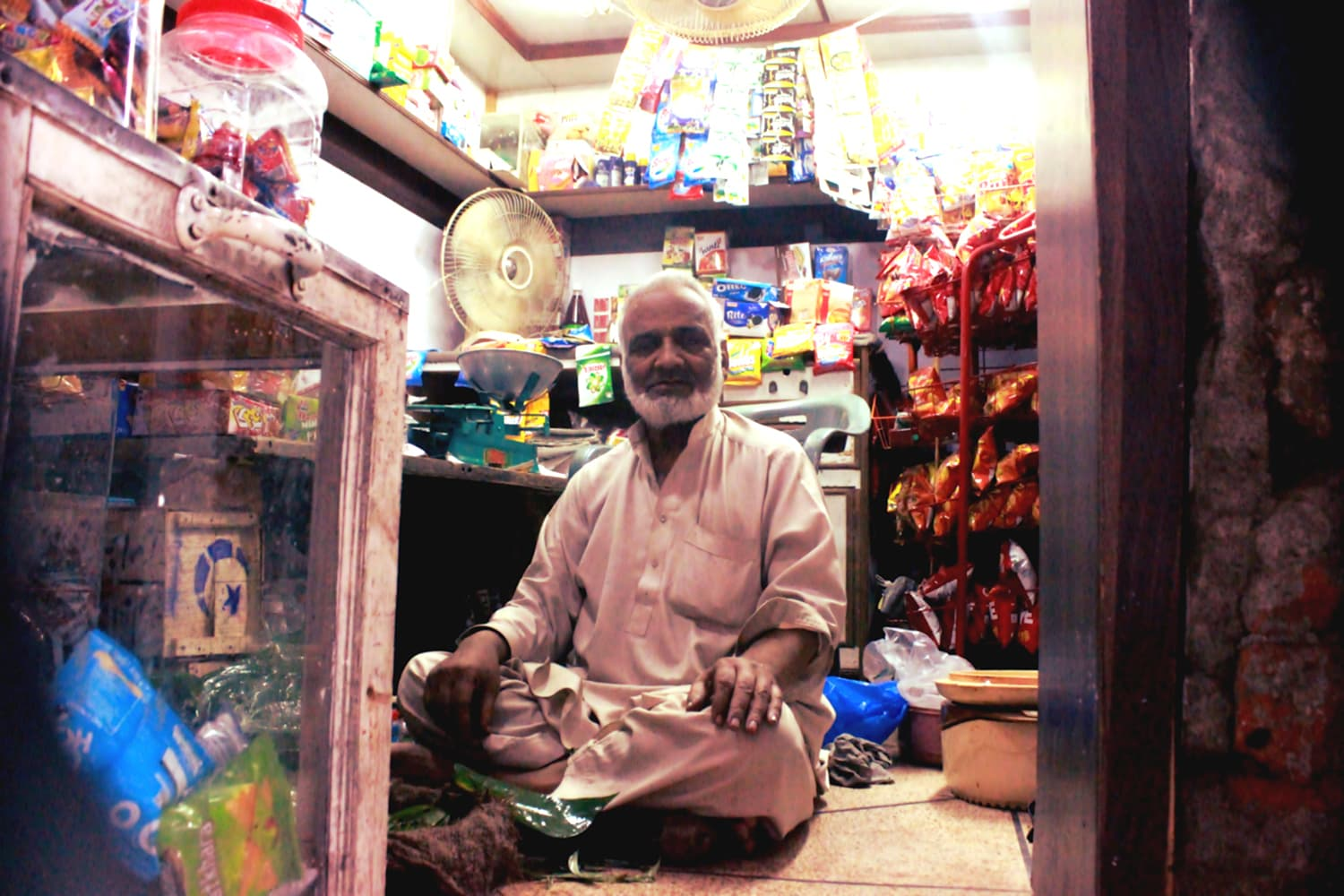 Gulzar Ahmad sitting at his small shop in Saidpuri Mohallah.