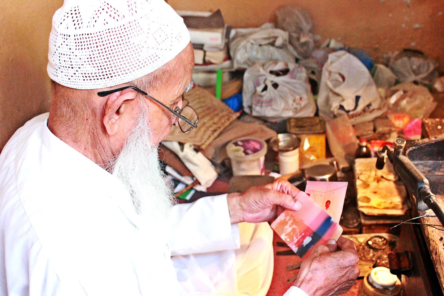 Hameed Ali Shah looking at old family pictures. – All photos provided by the author