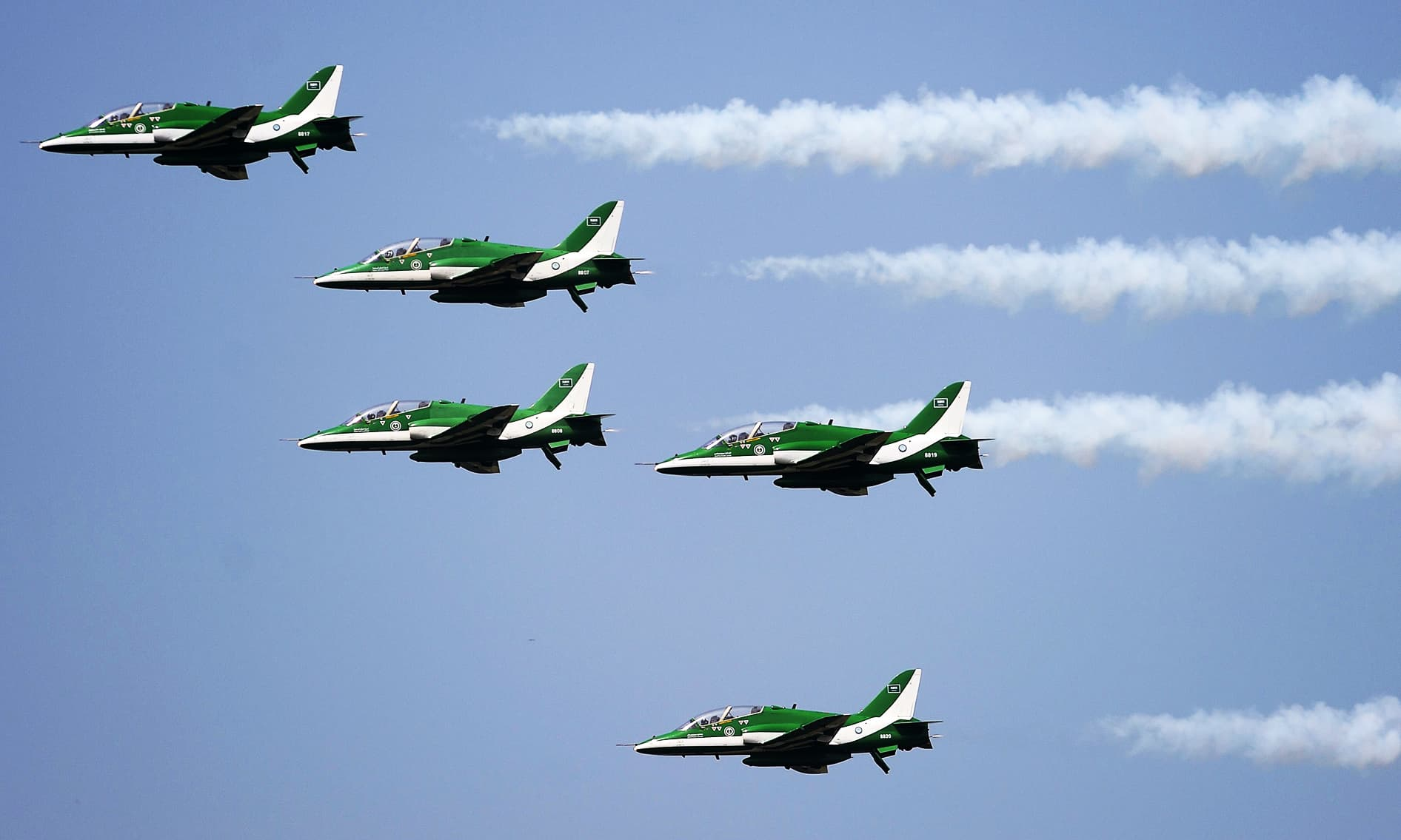 Air planes fall into formation during the airshow in Islamabad on the eve of independence. —AFP