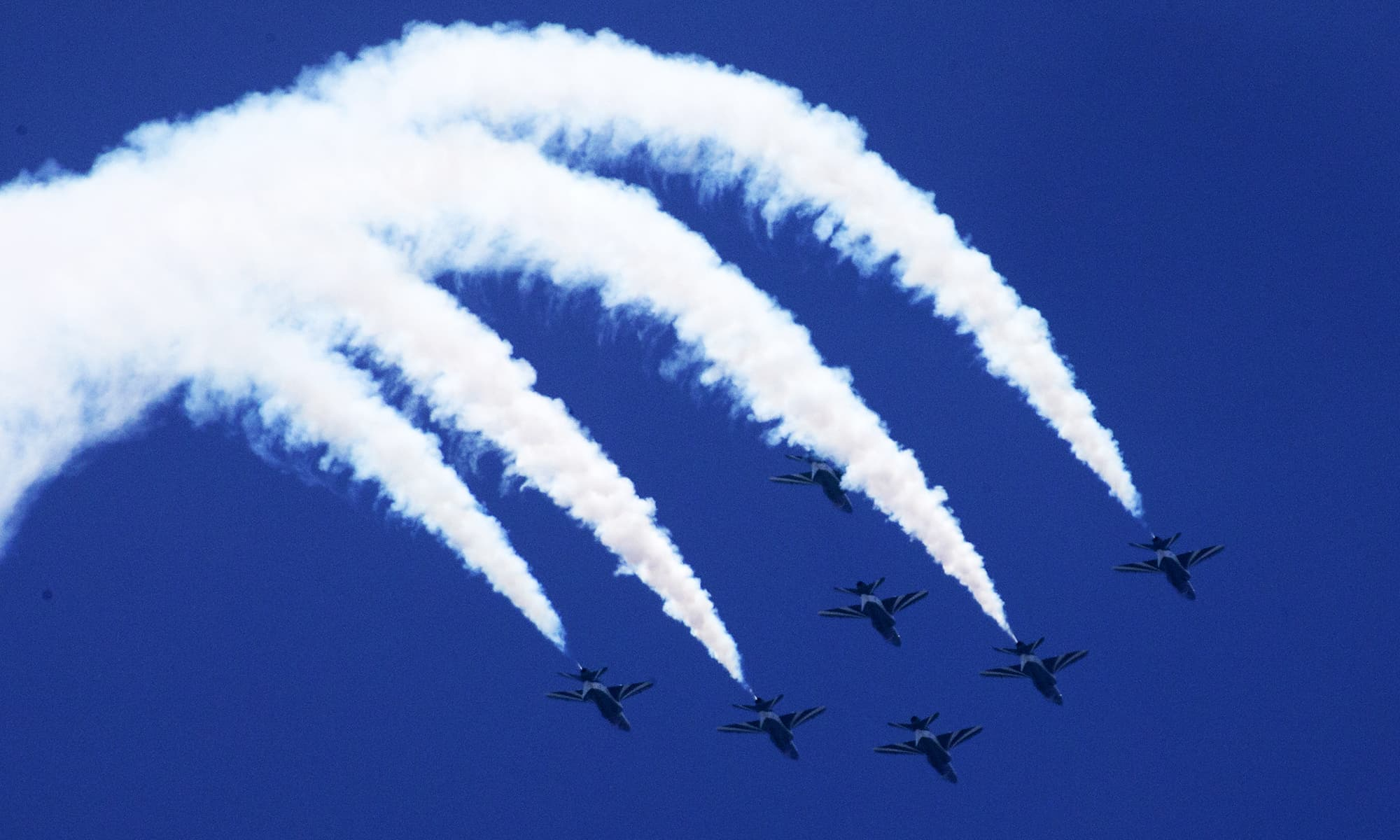 A team of pilots performs at the airshow in Islamabad. —AFP
