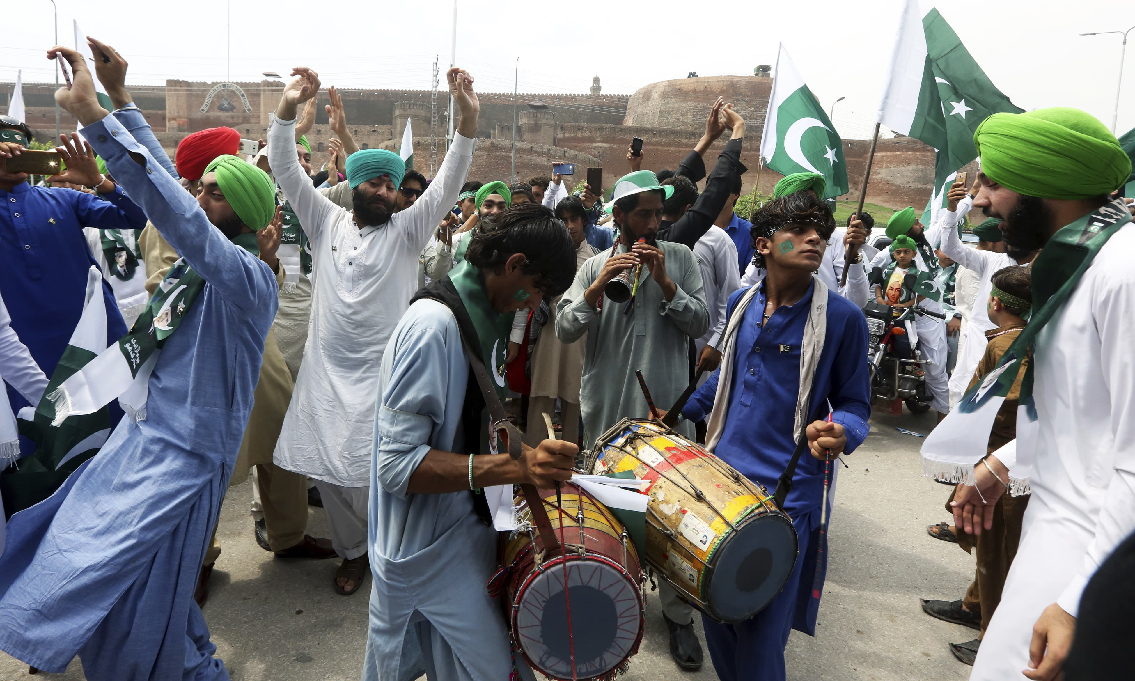 People from the Pakistani Sikh community celebrate the 70th Independence Day in Peshawar. —AP