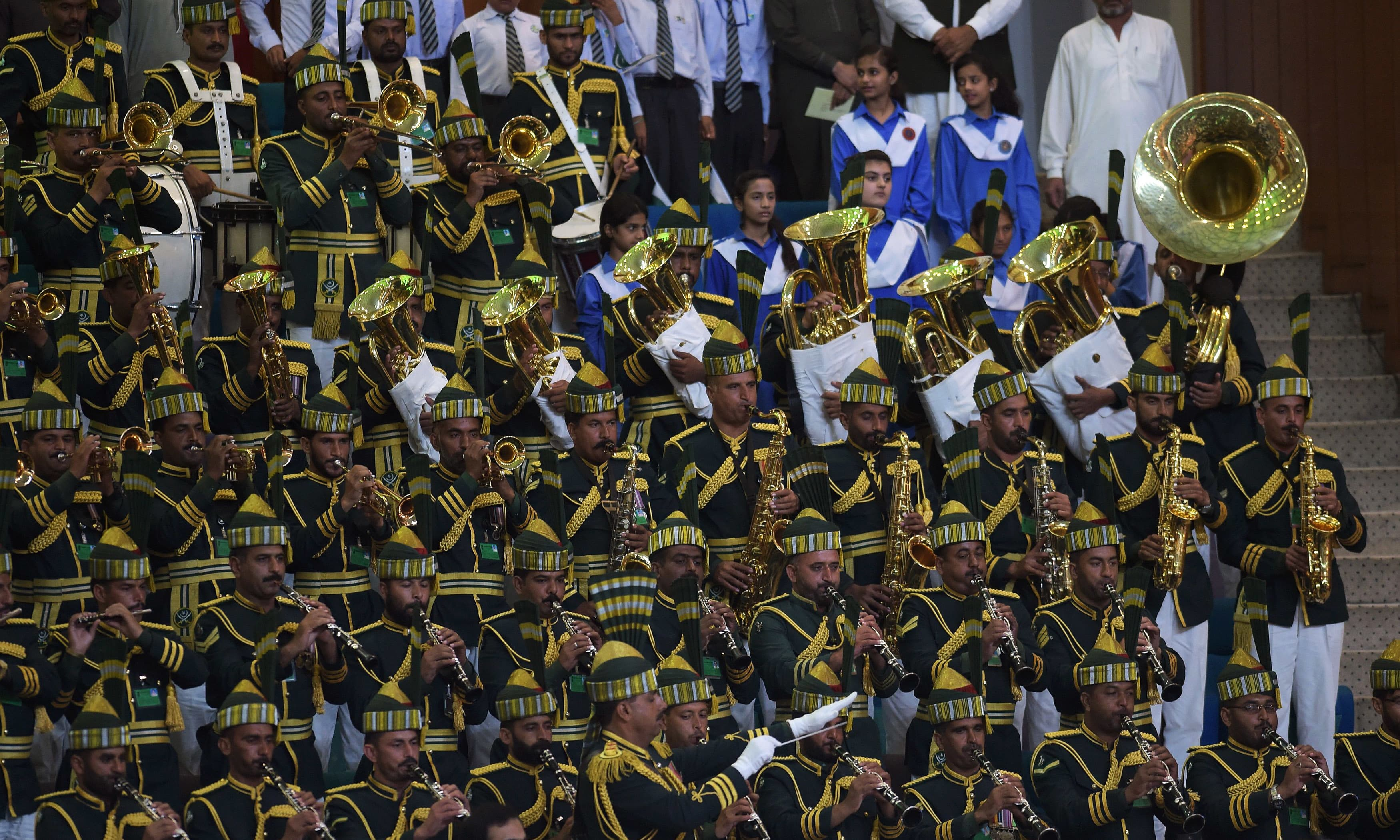 A military band performs during a flag hoisting ceremony. —AFP
