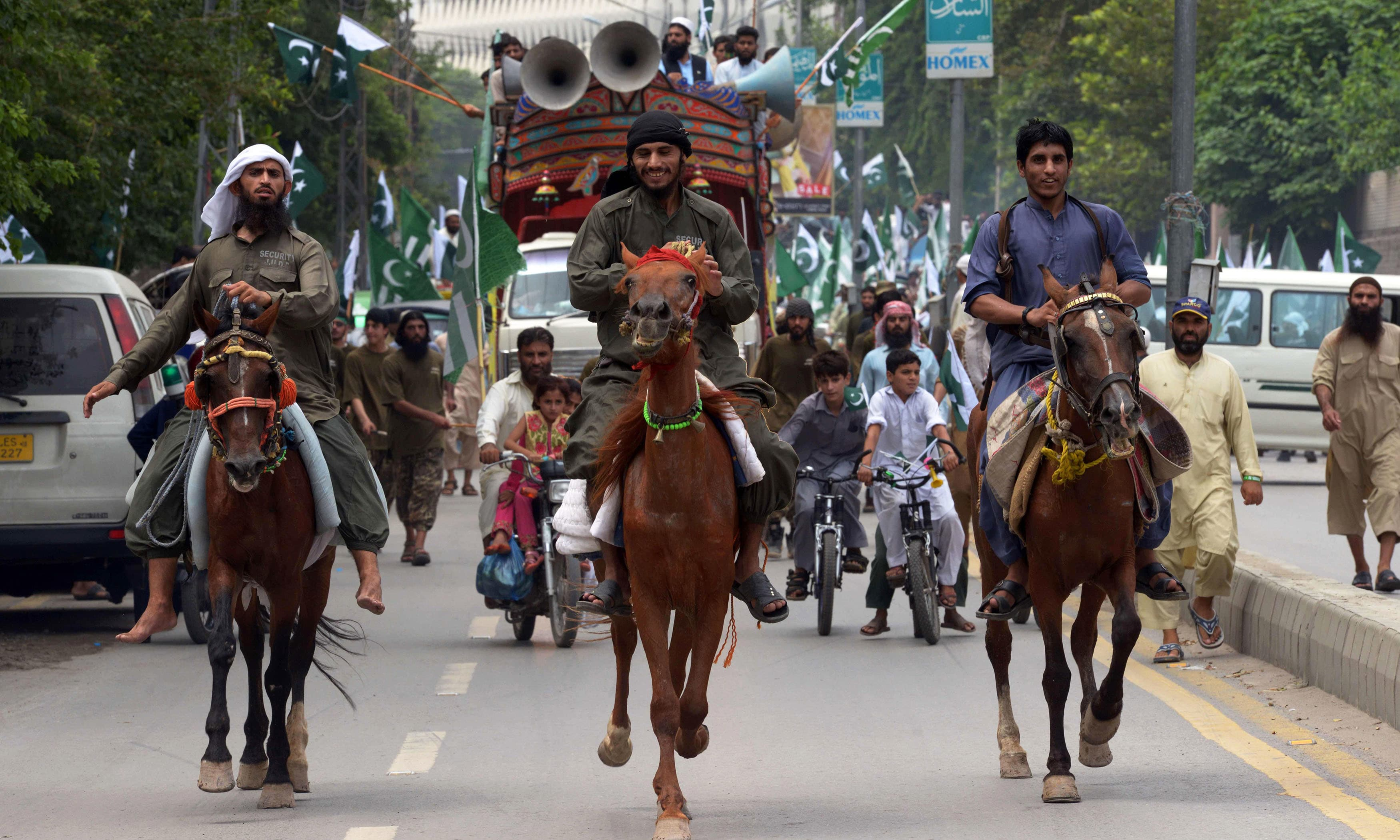 Residents march on horses during a rally in Peshawar. —AFP