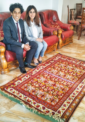 MIR Hassan Malkani and his wife Farzana with the rug Moolo gave his grandfather Ali Gohar Malkani. —Photo by writer