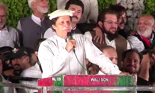 PTI Chairman Imran Khan speaks to the crowd at Liaquat Bagh.—DawnNews