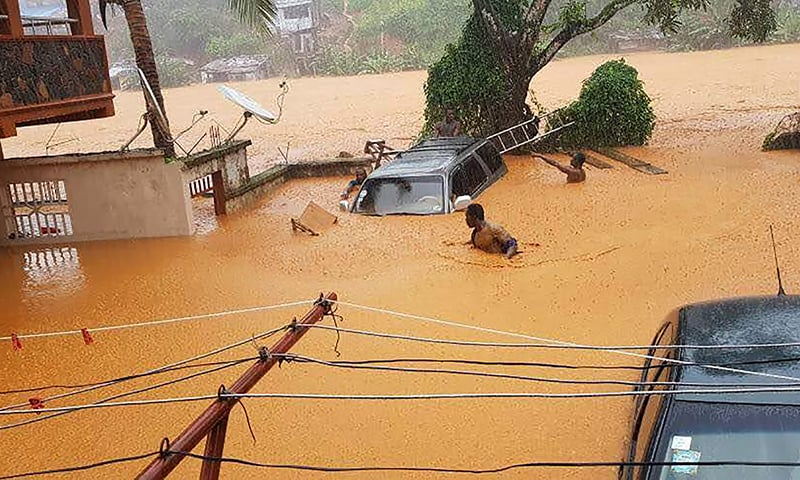 The picture shows flooded streets in Sierra Leone's capital of Freetown.─AFP