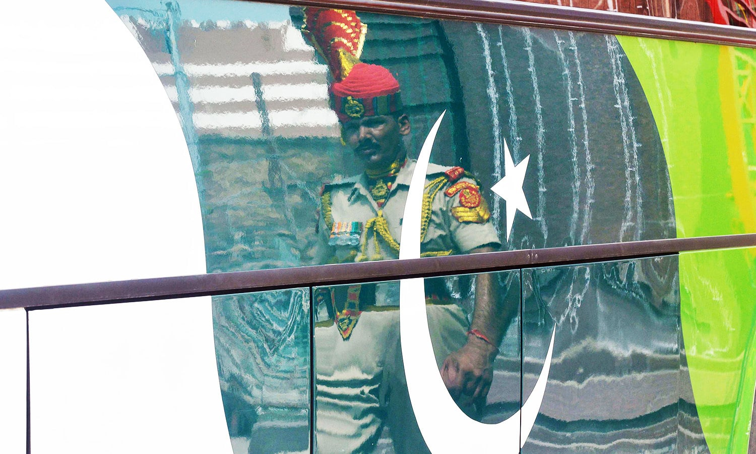 An Indian BSF soldier escorts the Pakistani Delhi-Lahore bus as India's marks its Independence Day at the India-Pakistan Wagah border post.—AFP