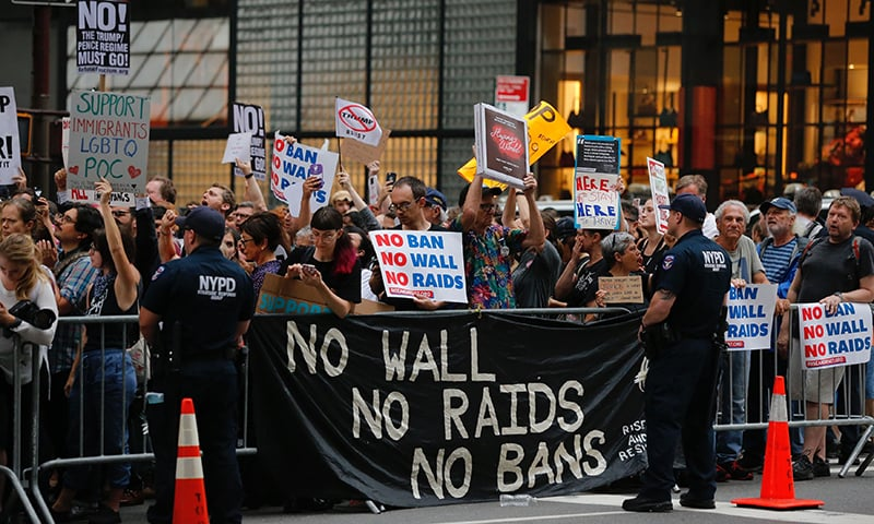 Protesters gather near Trump Tower to protest against attacks on immigrants under policies of US President Donald Trump.─AFP