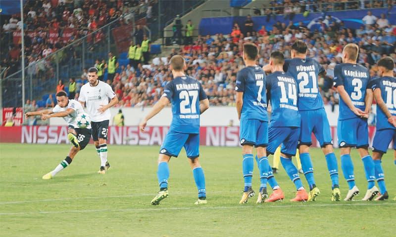 SINSHEIM (Germany): Liverpool's Trent Alexander-Arnold (L) shoots to score on a free-kick during their Champions Leagues playoff first leg against 1899 Hoffenheim at the Rhein-Neckar-Arena.—AP