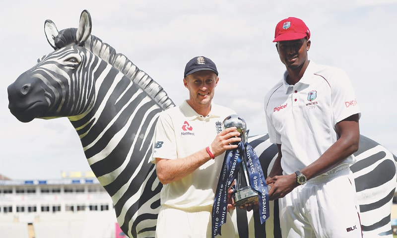 RIVAL captains, England's Joe Root (L) and Jason Holder of the West Indies, pose with the series trophy on the eve of the first Test at Edgbaston.—Reuters