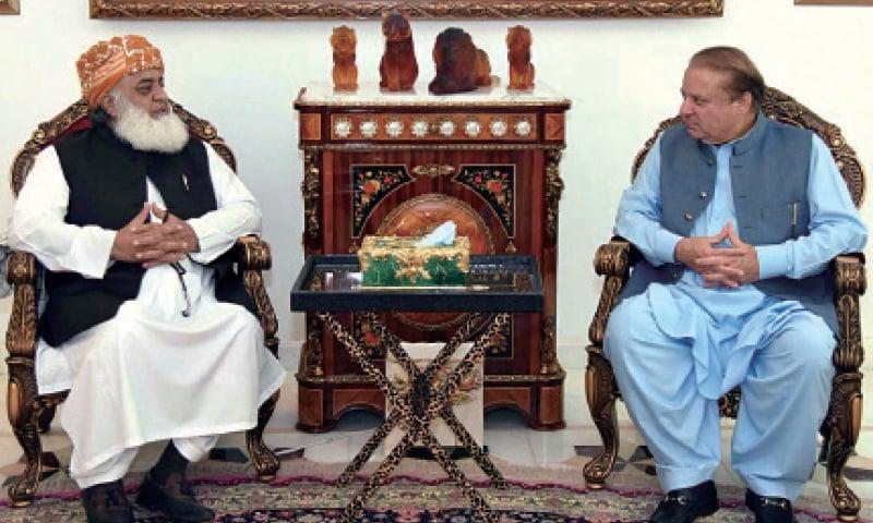 JUI-F chief Maulana Fazlur Rehman calls on former prime minister Nawaz Sharif. — Online