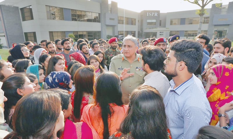 RAWALPINDI: Chief of the Army Staff Gen Qamar Javed Bajwa interacts with students during his visit to the  Inter Services Public Relations directorate on Thursday.—INP