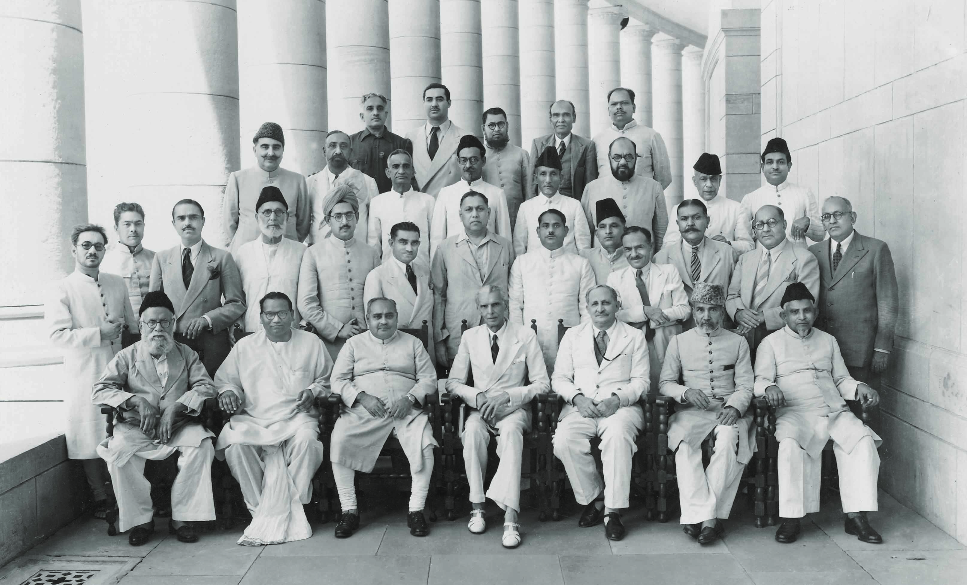 Quaid-i-Azam Mohammad Ali Jinnah (first row, centre) with members of the Central Legislative Assembly for the Muslim League in Delhi, 1946. Seated second and third from the left is Jogendra Nath Mandal and Khawaja Nazimuddin; seated third from the right is Sir Yamin Khan. Mohammad Amir Ahmed Khan, the Raja of Mahmudabad, stands on the extreme left; Nawabzada Liaquat Ali Khan and I.I. Chundrigar are on the extreme right in the second row. — I.I. Chundrigar Family Collection/ Dawn/White Star Archives