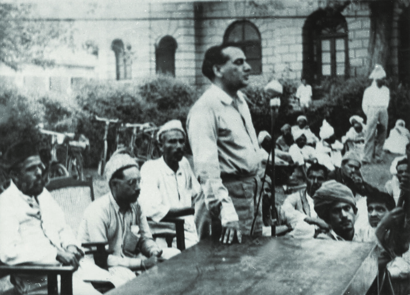 The poet Faiz Ahmed Faiz addresses the members of the Postal Workers Union at the Lahore GPO in 1949. Faiz is president of the PWU, and, during his tenure, he works aggressively towards securing workers' rights. — The Faiz Ghar Archives, Lahore