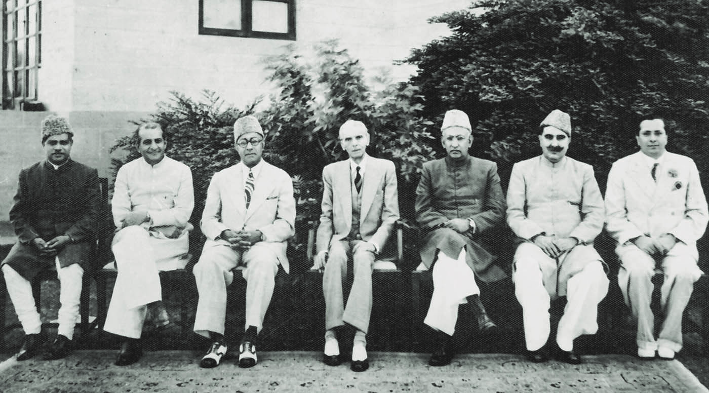 The first cabinet of Pakistani is formed on August 15, 1947 at Governor-General House, Karachi. Members include, from left to right, Mir Fazlur Rahman, Malik Ghulam Muhammad, Nawabzada Liaquat Ali Khan, Quaid-i-Azam Mohammad Ali Jinnah, I.I. Chundrigar, Sardar Abdur Rab Nishtar and Abdus Sattar Pirzada. —​ Dawn/White Star Archives
