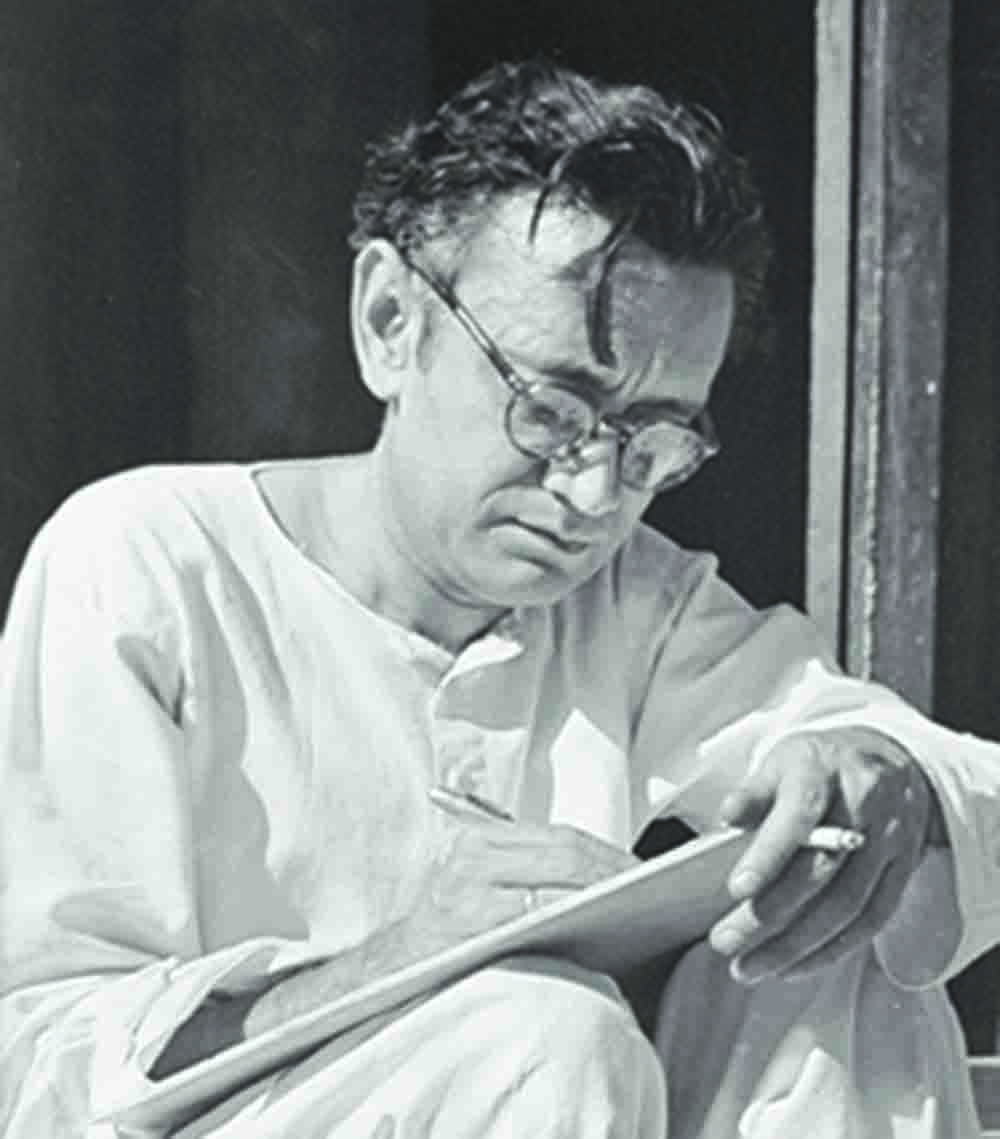 In this photograph taken by Khatir Ghaznavi, Saadat Hasan Manto is deep in composition, as he holds a cigarette in his left hand at his residence, Laxmi Mansion, in Lahore in January 1948. — Manto Family Archives in the possession of Nusrat Jalal, Lahore