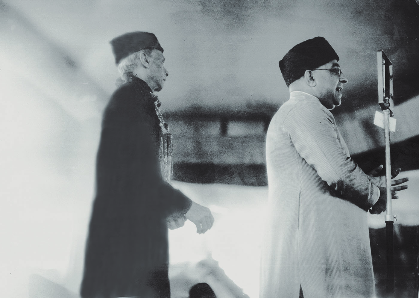 Nawabzada Liaquat Ali Khan addresses members of the All-India Muslim League at a meeting in April 1943, in Delhi, as Quaid-i-Azam Mohammad Ali Jinnah looks on. —​ Dawn/White Star Archives