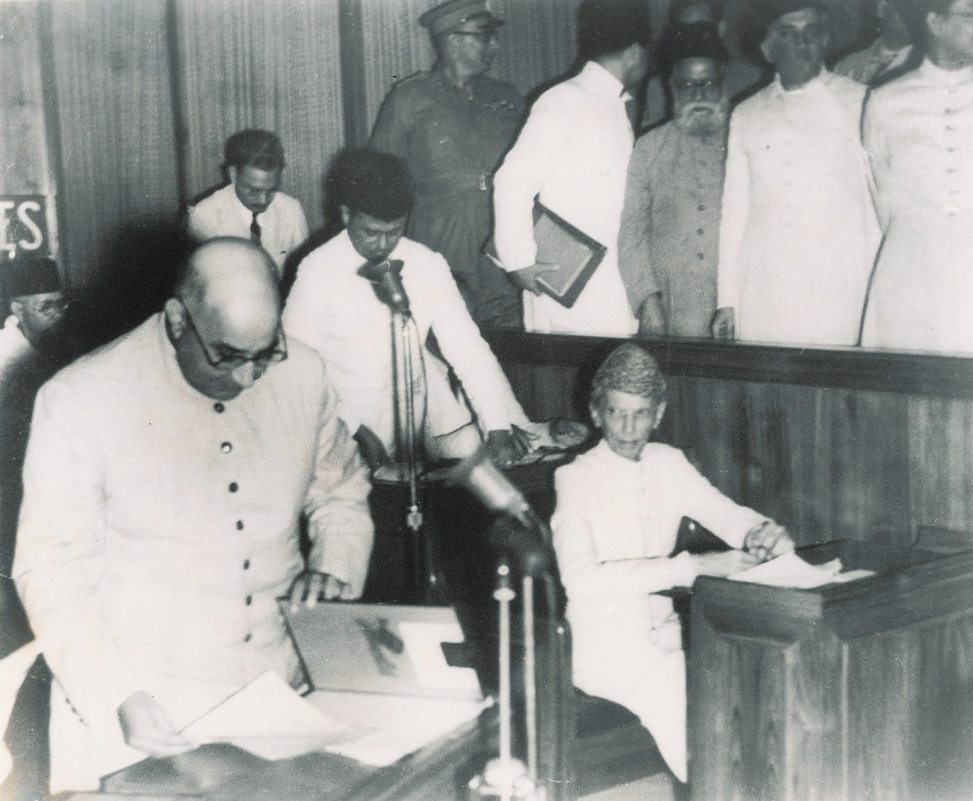 Nawabzada Liaquat Ali Khan casts his eye over the election forms that result in the elevation of Quaid-i-Azam Mohammad Ali Jinnah to the presidentship of the Constituent Assembly of Pakistan at its first session on August 11, 1947, in Karachi. —​ Dawn/White Star Archives