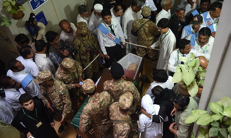 Pakistan Army personnel and others gather around the coffin of Ruth Pfau before her funeral ceremony in Karachi. — AFP